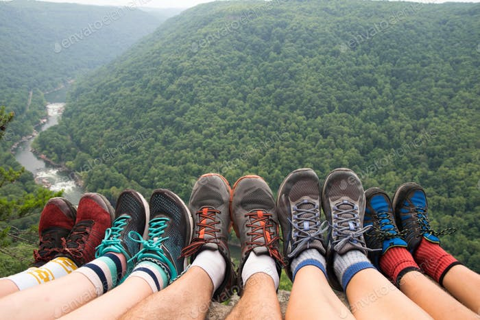 Feet Hanging Over the Edge at the End of a Hike to the Top of the Gorge