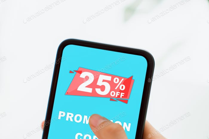 Woman holding smartphone to enter the code to get a discount from the store.