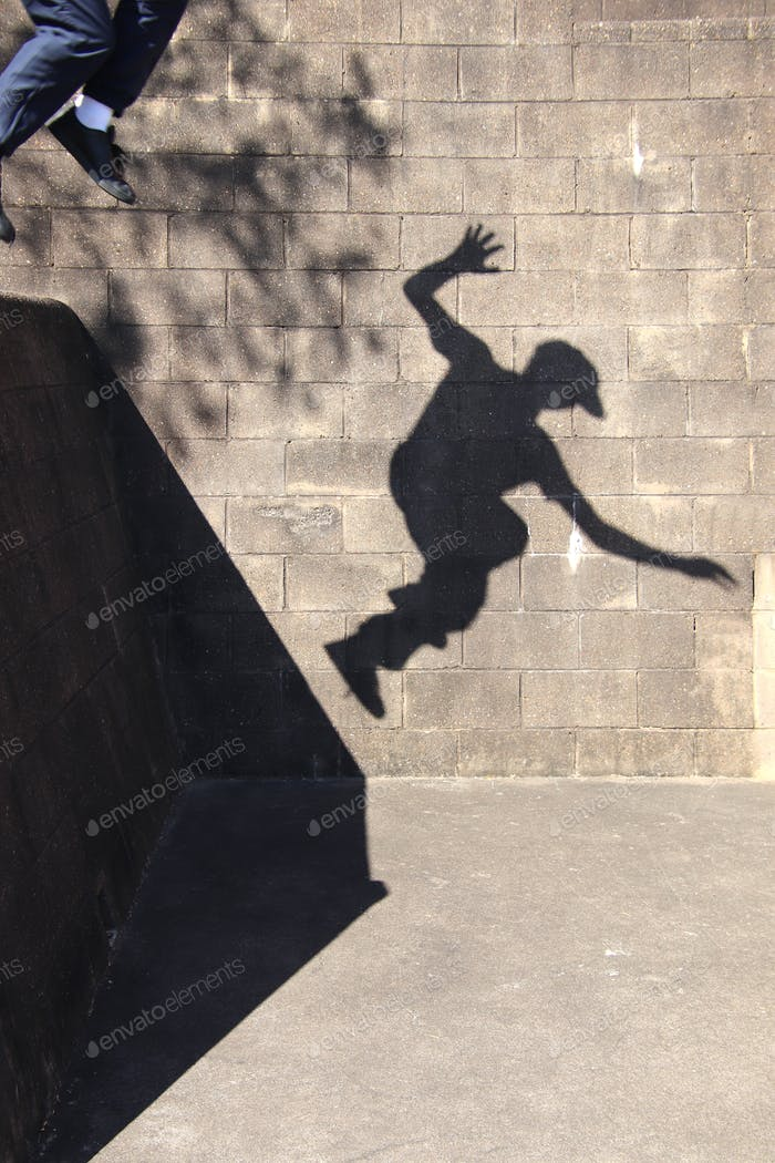 Shadow of a teenager jumping to the ground