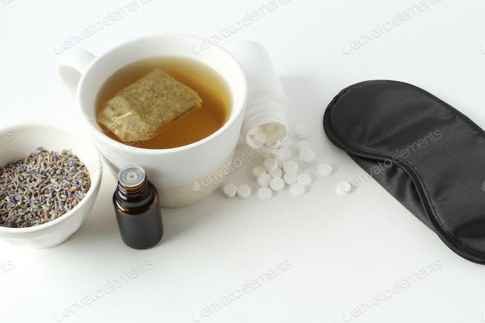 Insomnia remedies. Tea, lavender, essential oils and sleep mask