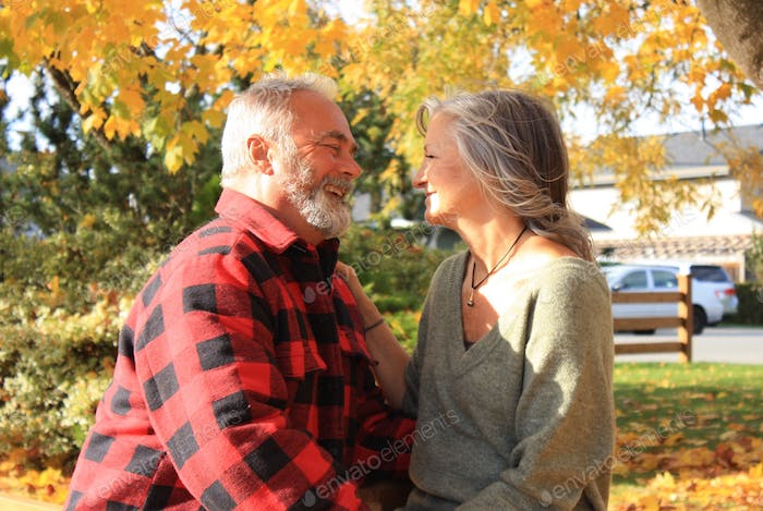 A newly Retired couple in love in autumn