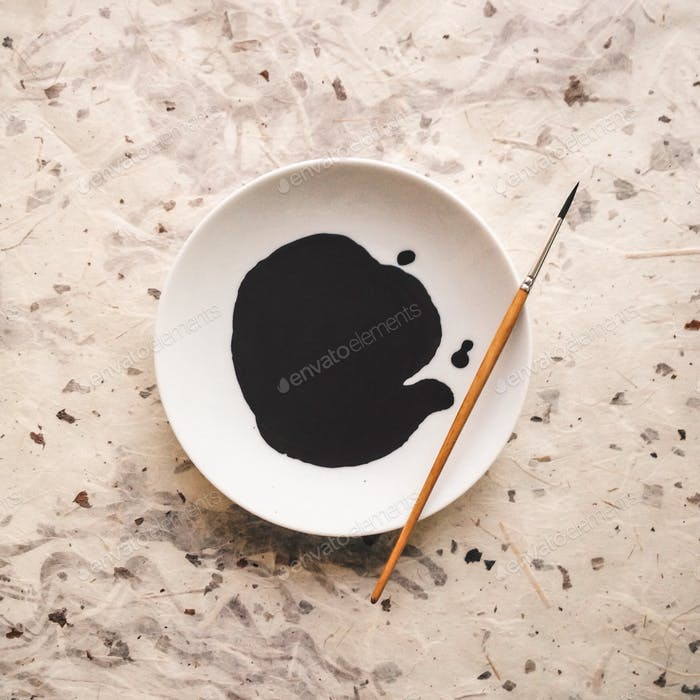 Black ink on a white plate