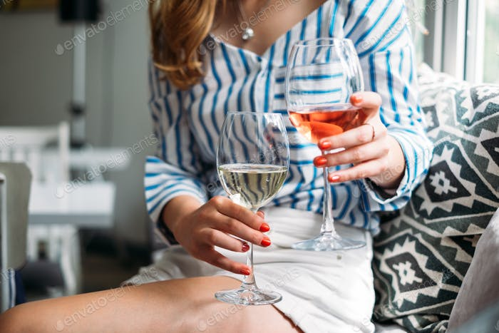 Woman holding two glasses of wine
