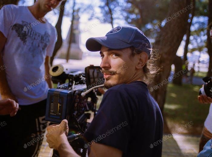 Director of photography shooting on big cinema camera. Cameraman, movie, shoot film, shooting