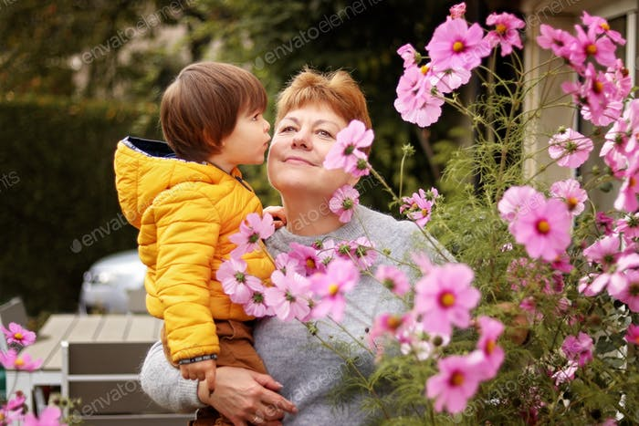 Nominated ❤️ Portrait of happy senior beautiful 60 years old grandmother holding her little grandson