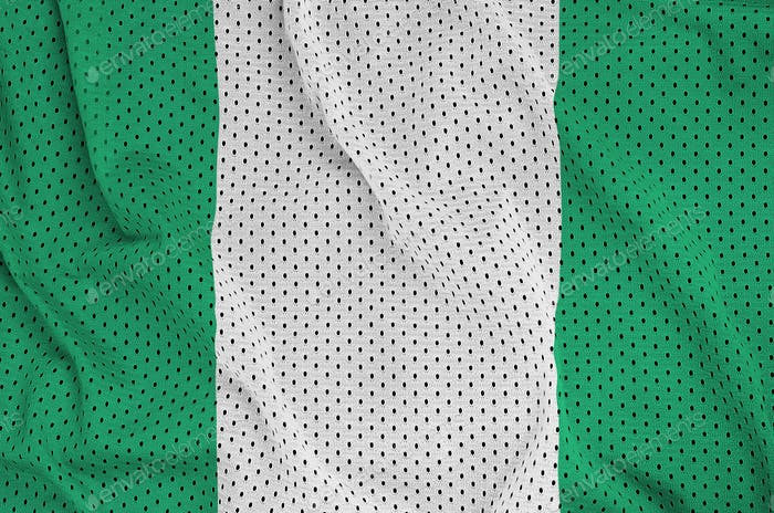 Nigeria flag printed on a polyester nylon sportswear mesh fabric with some folds