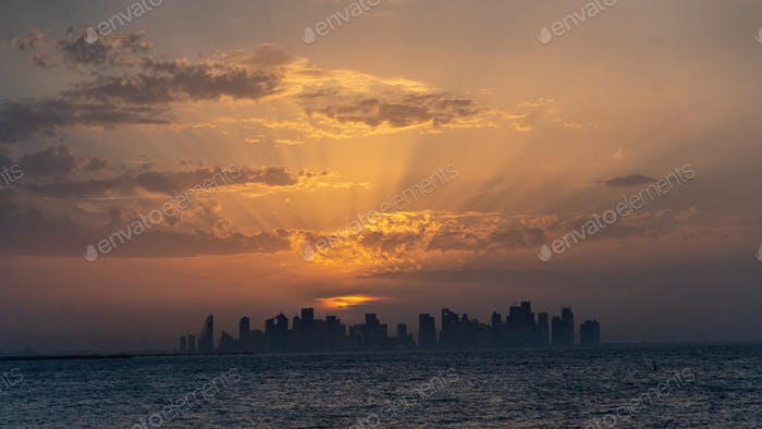 Doha skyline. Orange sky. Golden hour. Qatar. Travel. Silhouette. Sky. Qatar airways.