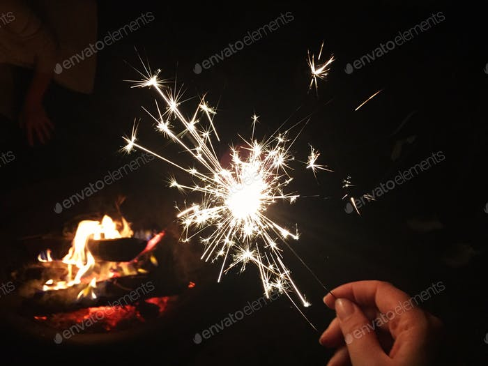 Sparklers around a campfire for Independence Day.