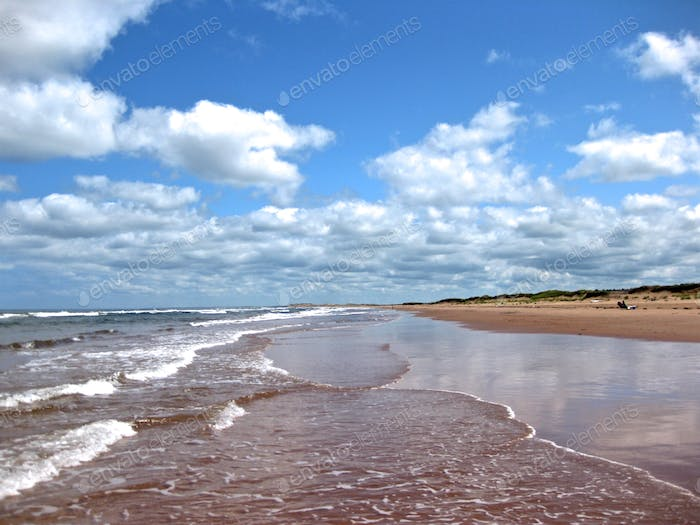 Red sand and waves. Prince Edward Island, Canada