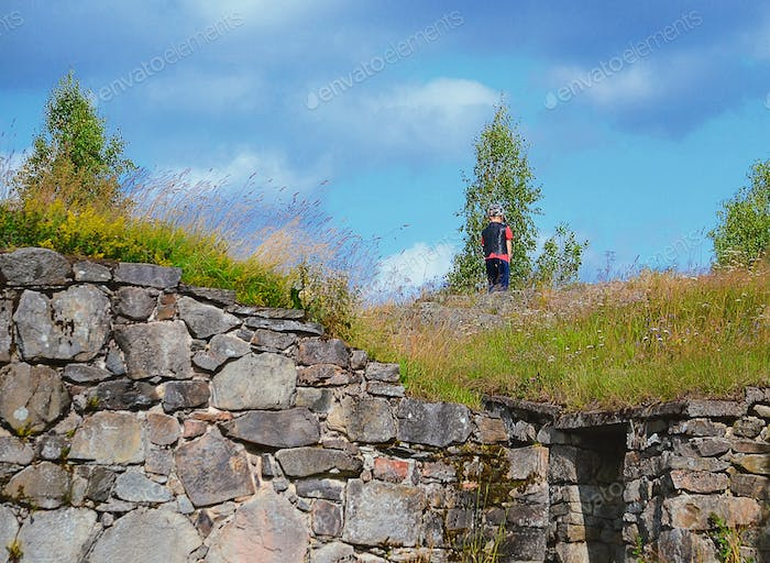 Boy on the top of old ruins