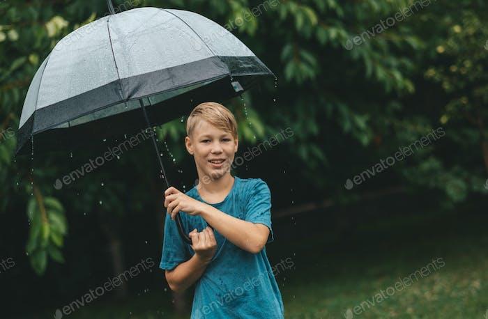 rain boy with umbrella