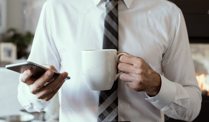 Businessman with phone and coffee torso