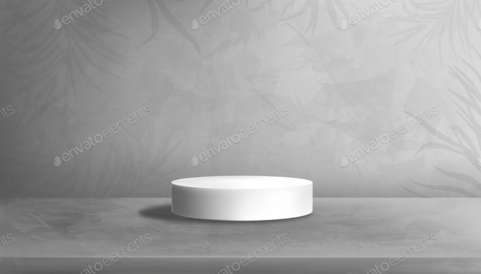 White Podium on Concrete floor in Studio Room with palm leave on Gray Cement Wall Texture Background