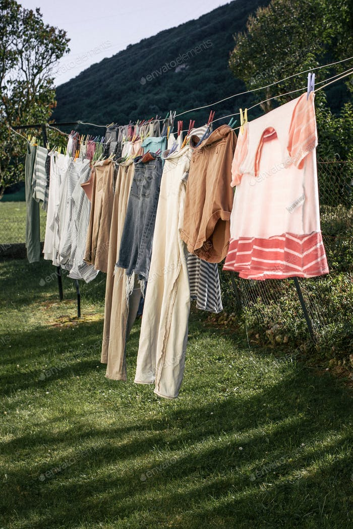 Clean clothes hanging on the clothes lines drying