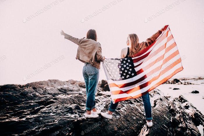 Young girls cheering with USA flag