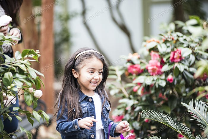Little girl with flowers.