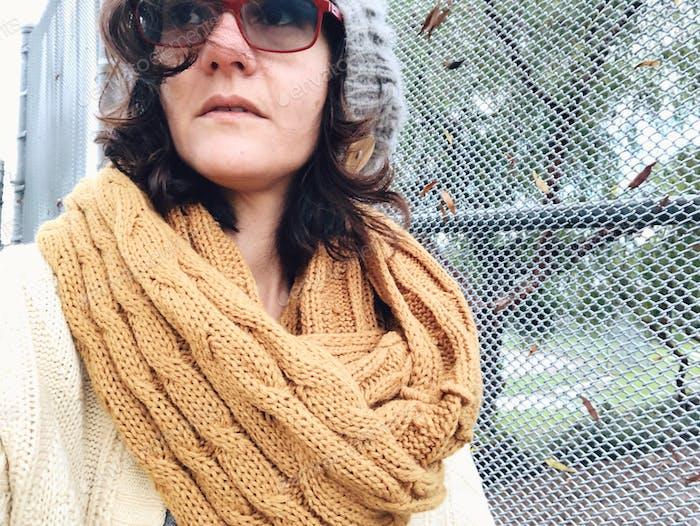 Winter fashion. Chunky yellow scarf