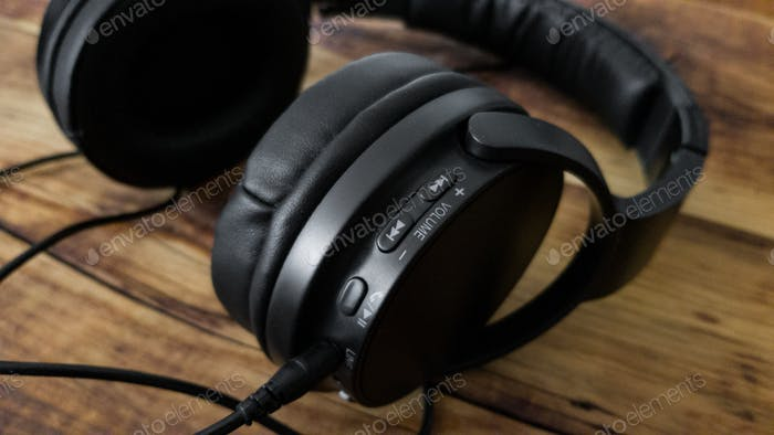 Black wireless headphones with a wired connection option