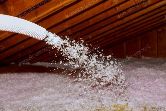 Spraying Blown Fiberglass Insulation for roof technician spraying foam insulation using plural