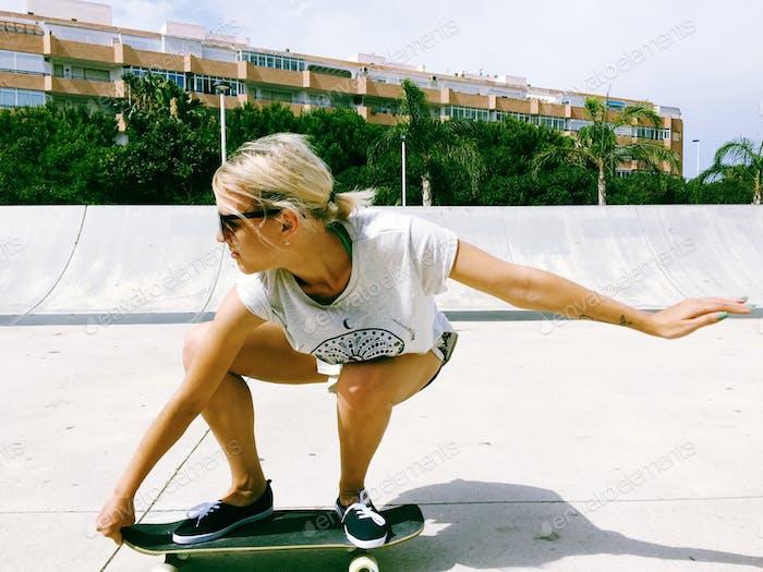 Girl riding on the skateboard