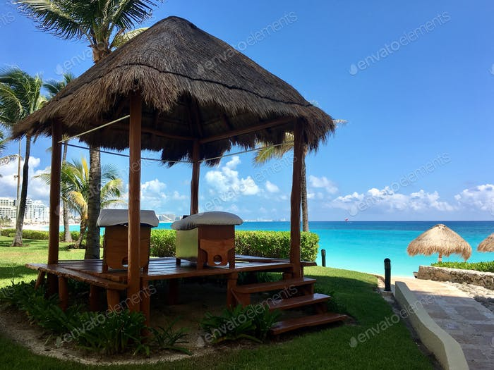 Resort massage tables next to ocean