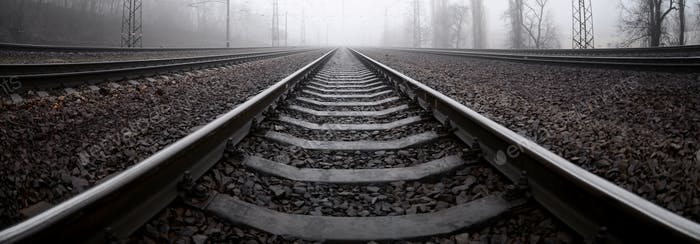 The railway track in a misty morning