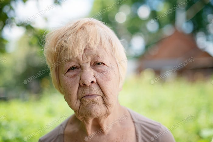 Wrinkled face of a 90 year old woman.