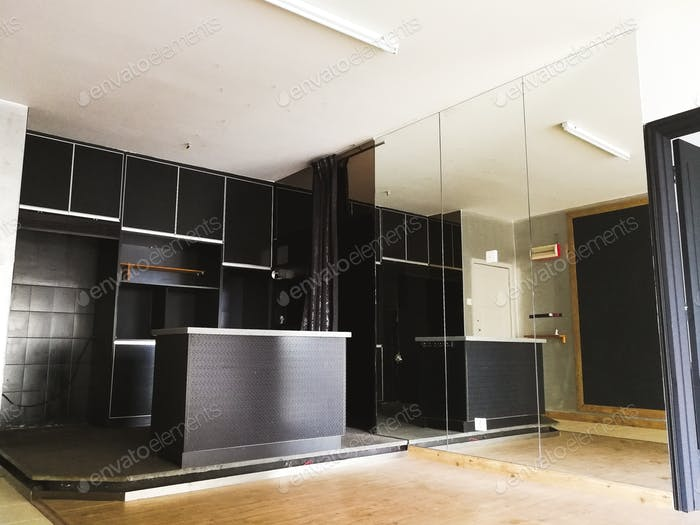 black kitchen with island and full height mirror