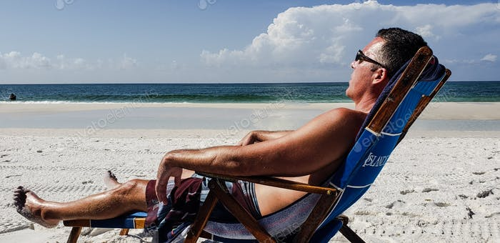 Millennial naptime is all day long when working on his tan and vitamin D.