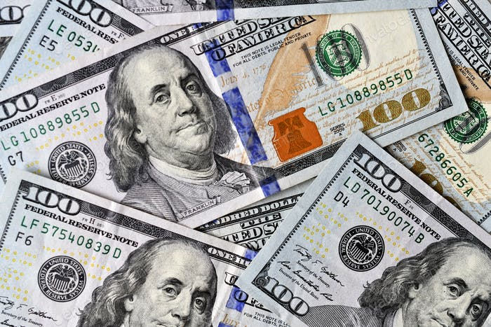 Flat lay background of 100 hundred dollar bills - currency, cash, money, economy, spending
