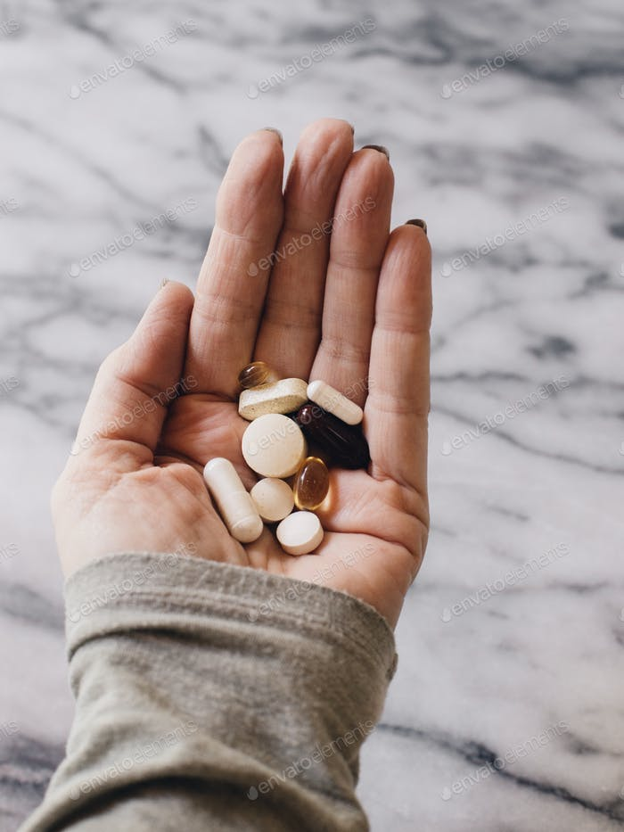 Vitamins in hand