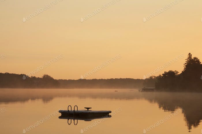 Peaceful Minnesota lake at sunrise