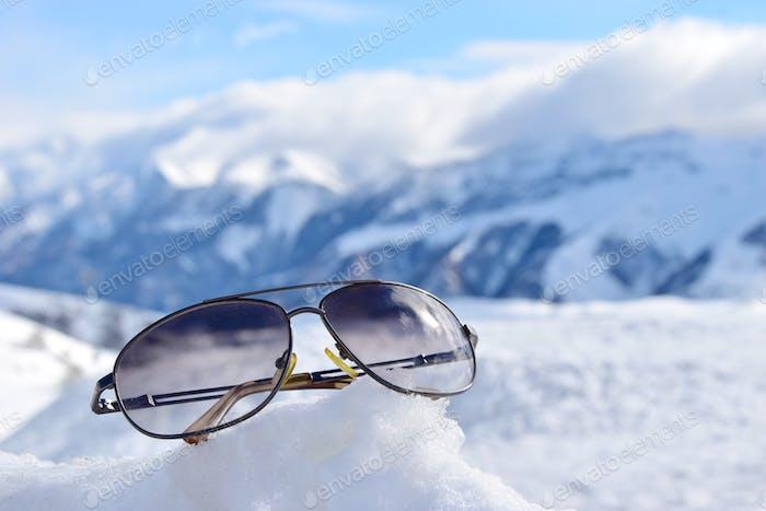 Sunglasses on a snow