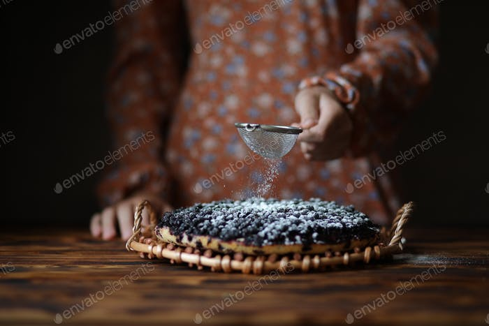 Cooking blueberry pie.