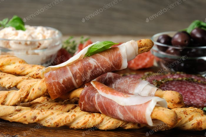 Dish for Antipasto snacks with salami