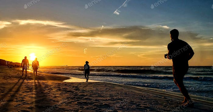 Early morning jogger on the beach is getting his fitness and exercise and training in while planning