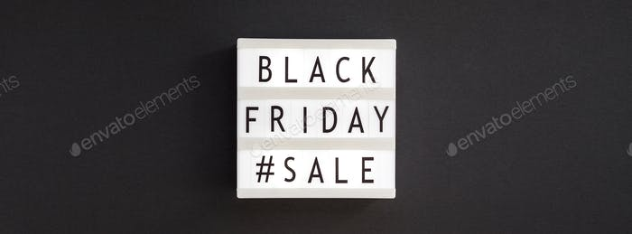 Creative Top view flat lay promotion composition Black friday sale text on white lightbox black