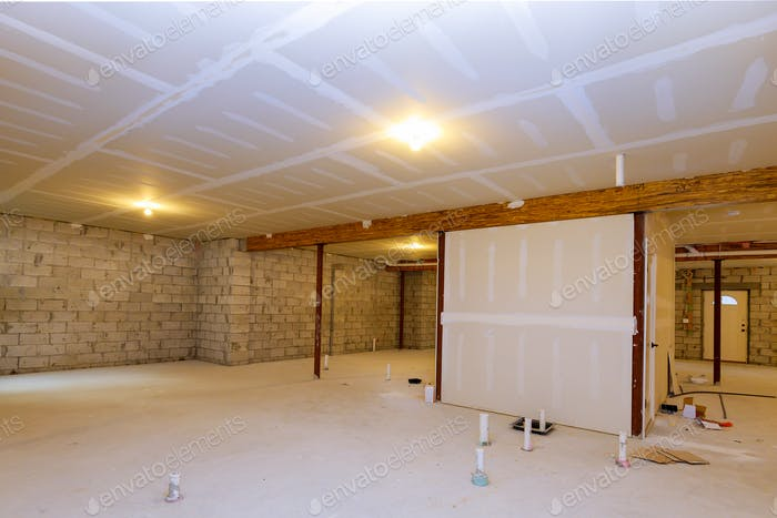 New residential construction home framing with basement unfinished view