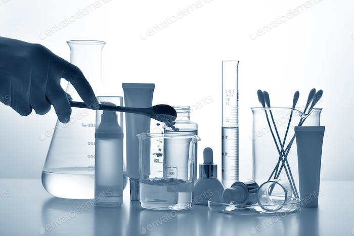 Dermatologist formulating and mixing pharmaceutical skincare