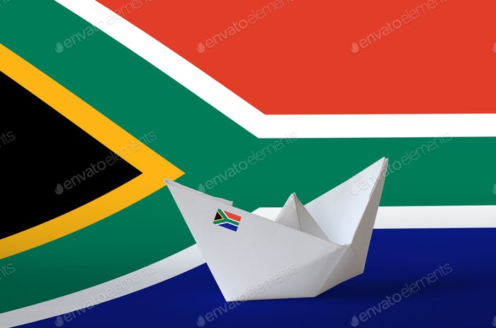 South Africa flag depicted on paper origami ship closeup. Oriental handmade arts concept