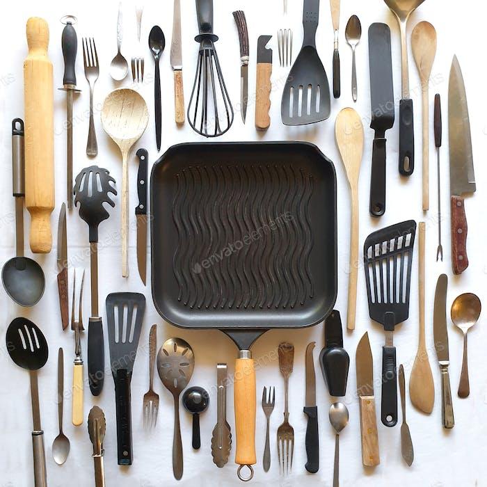 kitchen utensils arranged neatly on table,flat lay