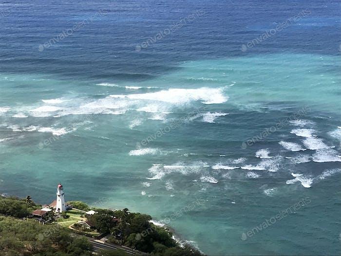 Lighthouse on the Pacific Ocean coastline.