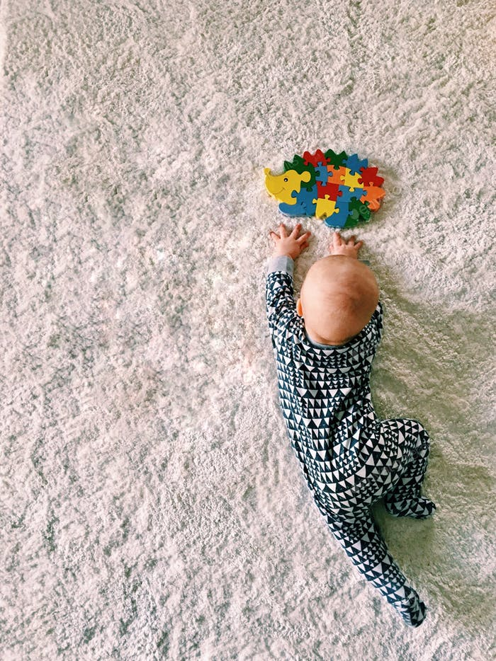 Baby boy is trying to crawl
