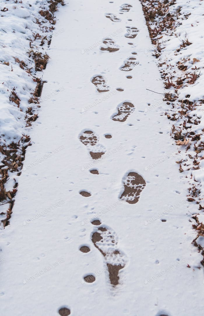 Footsteps in snow on a path