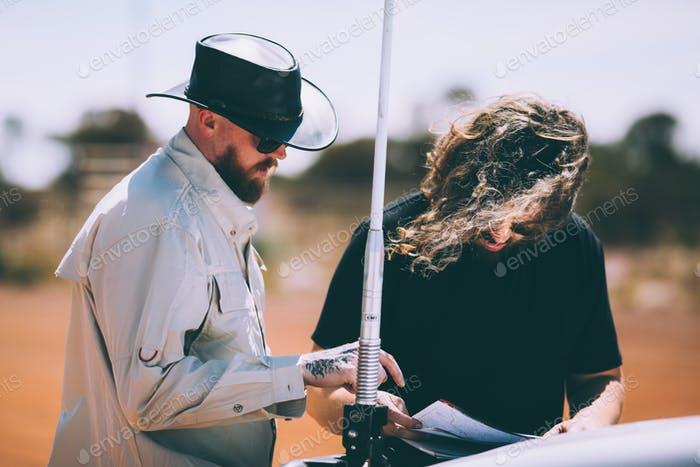 Checking maps during road trip
