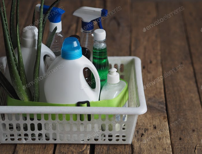 The idea for a natural detergent. Natural leaves of aloe plant with bottles of laundry detergent.