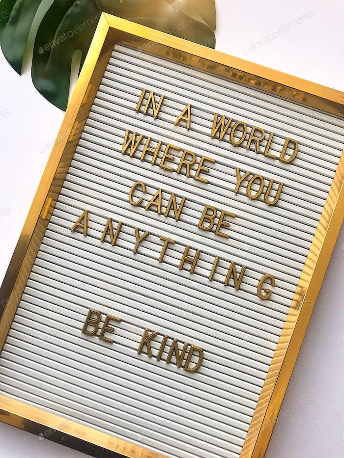 Positive message on golden letterboard