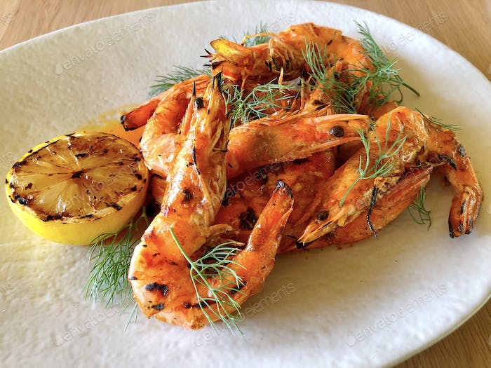 BBQ barbecued shrimps in butter and lemon sauce