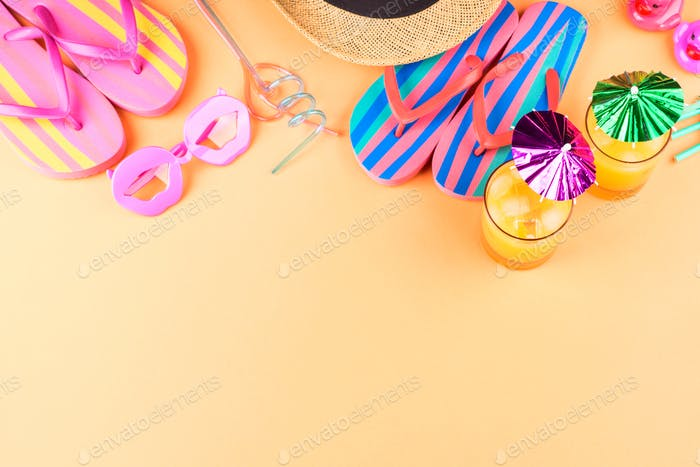 Vacation on the beach concept with summer cocktails and accessories - hat, flip flops, sun glasses.