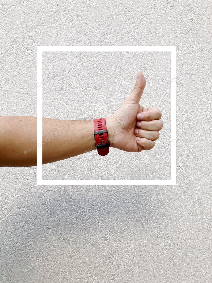 Man's thumb up